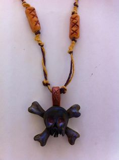 I love the new boy necklace made from clay and hemp cord. knitfit.org