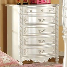 """Alexandra Chest CM7226C $388 Description : With a delicately decorated motif design, these case goods add the missing pieces to any storybook bedroom. With French dovetail drawers and Pearl White finish. Features : Fairy Tale Style Hand-Brushed Gold Accents French Dovetail Drawers Solid Wood, Others Pearl White Finish Dimension : Chest : 32""""W X 18""""D X 42""""H"""