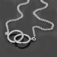 A personal favourite from my Etsy shop https://www.etsy.com/hk-en/listing/160711555/infinity-necklace-interlocking-circle