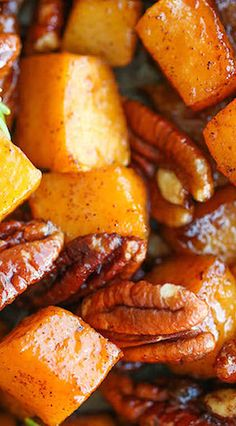 Squash, olive oil, maple syrup, brown sugar, cinnamon, nutmeg, pecan halves, & rosemary. Great side dish for Thanksgiving:)
