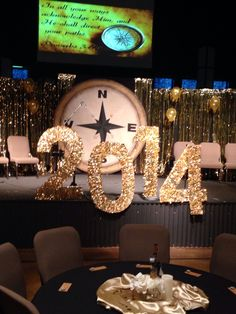 Graduation stage decoration. Compass. In all your ways acknowledge Him.