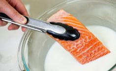 Soak Fish in Milk for Odor-Free Cooking  When you're buying fish, it's important to make sure your fish smells like the sea, and not, well, like fish. That's one indicator of freshness. However, after the fish has come home, gone into the fridge, or been frozen and thawed, even your freshly bought fish may start to take on a fishy smell. The solution is easy: A quick soak in a bowl of milk, and that fishy smell is all gone.