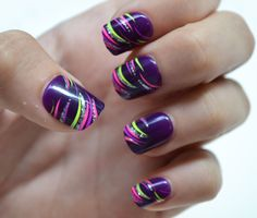 swooshy stripes in neon pink, yellow & light purple + silver glitter over purple polish nail art design