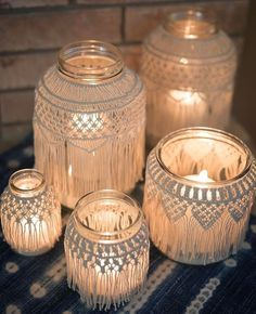 handmade bohemian glass jar covers made from intricate macrame with candles inside for lighting wedding prop