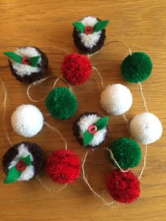 Christmas Pudding Pom Pom Garland. This garland is made of 13 Pom poms (4 puddings and 9 smaller poms), all threaded on jute twine (2m in length) with loops at the ends for hanging. Each pudding has a red button and green felt leaves. All 4 have small jute twine loops. Puddings measure 3.5cm in diameter. The sparkly red poms, green and white at 3cm in diameter each. A perfect decoration for Christmas