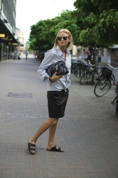 Birk style: denim shirt with leader skirt and black clutch.