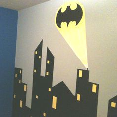 Batman wall just completed for my son's superhero room.  Buildings were time consuming, but very easy.  Just lots of time and painter's tape!  The bat signal was done by my very talented mom!