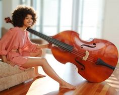 Esperanza Spalding  --- If she came to play at my birthday, lawd have mercy! Her music or someone who can play her music?