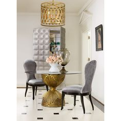 A custom-cast lotus bloom powdered in gold forms the base of this unique table. Available glass top reveals all beneath. Glass top sold separately.
