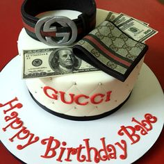 Gucci cake with matching belt and wallet. Made with Cake Couture fondant.