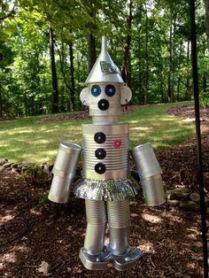 repurposed tin cans to the wizard of oz s tin man his girlfriend the tin lady… Tin Can Man, Tin Man, Tin Can Crafts, Diy Crafts, Garden Crafts, Tin Can Lanterns, Modern Plant Stand, Wizard Of Oz, Repurposed