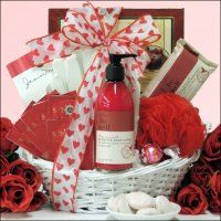 Send her this beautiful spa Valentine's gift basket for Valentine's Day filled with a lovely assortment of bath & body gift items, tea, cookies, candles and so much more. Includes Moisturizing Gloves for Hand Rejuvenation and Bath Net Exfoliating Puff. This great Valentine's spa basket features all natural Simply Be Well Organic Pomegranate Cleansing Body Bar and Hand & Body Lotion. $54.99