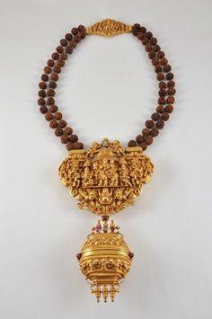 gowrishankaram necklace worn by shaivaite priest