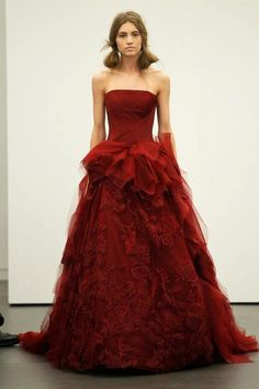 Vera Wang  Look 3 - Crimson strapless ballgown with hand-draped tulle bodice and honeycomb tulle skirt with embellished floating Chantilly lace and bias-cutorganza ruffle detail