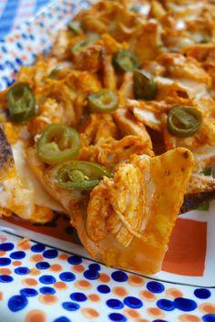 Buffalo Chicken Nachos - chicken, buffalo sauce, pepper jack cheese, jalapeños on top of Doritos - SO additive!!!