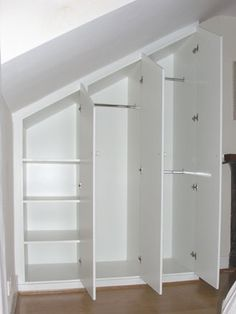 Wardrobes built into eaves space.