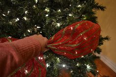 GREAT TUTORIAL Decorating A Christmas Tree With Mesh Ribbon  1) fluff branches, 2) add lights, 3) add ribbon,  4) add topper, 5) add ornaments via kristenscreationsonline