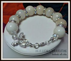This bracelet is sure to get a lot of attention. I used 18mm Grey Quartz beads which look like Snowballs. Duck! And the rhinestone beads and AB finish crystals bring a whole lot of sparkle and glam. I can see this bracelet being worn to any Holiday party. The angel theme is also perfect for the Holiday season, but why not have a little angel with you all year long! This bracelet measures 7.75 inches and is finished with a silver lobster claw clasp. And is handmade in a pet-free and ...