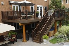 Using Trex decking, railing and lighting. The area under the deck is kept dry using Trex rain escapes allowing full use of the hot tub area under the deck at all times.