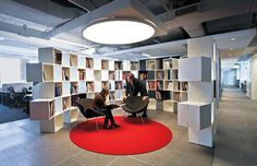 group ogilvy office. love the red circular rug and matching light above ogilvy u0026 mather new york group office p