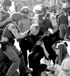 Twitter / OCongress: Inspiring photo. Clergyman arrested today fighting for economic justice of Walmart workers.