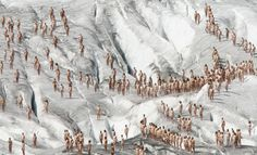 Naked volunteers pose for U.S. photographer Spencer Tunick on the Aletsch glacier on August 18, 2007.