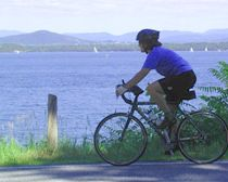 Cycling along Lake Champlain.  Image via www.experienceplus.com