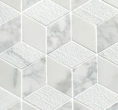 Carrara Cubed Marble tiles from Mandarin Stone. This classic Italian marble mosaic combines honed, polished and subtly grooved finishes to give a dramatic '3D cube' effect. http://www.mandarinstone.com