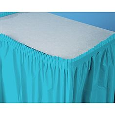 Save on our vibrant Bermuda blue plastic table skirt and dress up party tables.