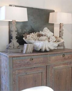 Decorating on the Half Shell: Clamshells in Home Decor I need that giant clam shell. Beach Cottage Style, Beach Cottage Decor, Coastal Style, Coastal Decor, Coastal Entryway, Seaside Decor, Cottage Chic, Coastal Living Rooms, Coastal Homes