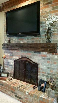 my new Railroad tie mantel! Rustic Fireplace Mantle, Brick Fireplace Makeover, Rustic Fireplaces, Farmhouse Fireplace, Home Fireplace, Wood Mantels, Fireplace Design, Farmhouse Decor, Tv Mantle