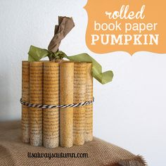 cool pumpkin decoration made from a book! use a thrifted book or one from the dollar store for inexpensive fall/Halloween decor - super easy!
