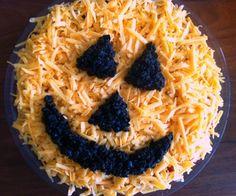 Carefully arrange chopped black olives to look like a jack-o-lantern face.