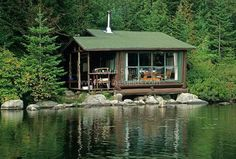 A small summer cabin in the woods.