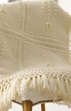Bring the essence of Ireland into your home with this simple Aran Crochet Throw from Coats & Clark. This free crochet afghan pattern makes a great gift for a housewarming and is the perfect blanket to cuddle up with when you enjoy the cool weather outdoors. Embellished with bobble stitching and finished off with fun tassels, this blanket is great for those crochet fans who are looking for a bit of a challenge.