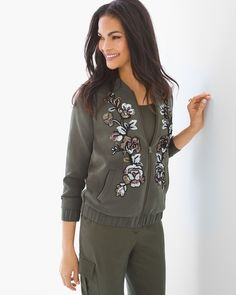"""The fashion flight plan? Be devastatingly chic. A classic silhouette takes a stunning new style direction in this silky embellished bomber jacket with sequined florals down the front.  A limited-edition, collectible piece inspired by our artisans' extraordinary adventures.  Long sleeves.  Pockets.  Zipper closure.  Shirring detail finishes a banded hem and cuffs.  Regular length: 23"""".  Petite length: 22.5"""".  Polyester.  Machine wash. Imported."""