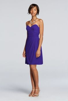 The striking sweetheart neckline on this short mesh bridesmaid dress with side draping is made for pairing with statement jewelry.   Sweetheart neckline and ruched bodice create an ultra-feminine slimming look.  Fully lined. Back zip. Imported polyester. Dry clean only.  Also available in extra length sizes as Style 2XLW10953.  To protect your dress, try our Non Woven Garment Bag.
