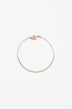 Thin Grey And Rose Gold Tube Bracelet / COS / $9