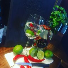 Opihr Gin garnished with chilli, ginger & lime Gin Garnish, Gin Mixers, Alcoholic Drinks, Cocktails, White Wine, Lime, Glass, Craft Cocktails, Cocktail