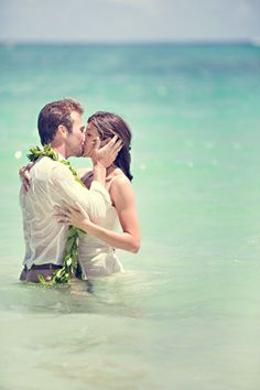 This couple sure wasn't afraid to get wet! A bit sensual, a bit romantic, this photo is full of love, if you dare.
