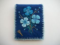Blue Needle Book Felt Case with Flowers Hand Embroidery and a Crochet Edge. $27.00, via Etsy.