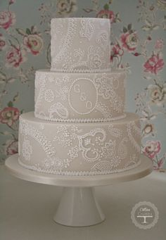 "For Gemma & Oliver @ Iscoyd Park yesterday. Sizes 5,8 and 11"" the piping took me 6 hours to finish.  Original lace design was from www.jenscakes.com who gave us permission to replicate it x"