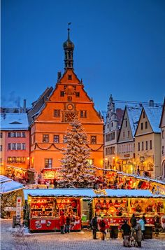 colorful booths - Rothenburg Christkindtmarkt is home to the 'schneeball,' a German confection made of fried dough and covered in sugar. Photo: Bayern Tourism
