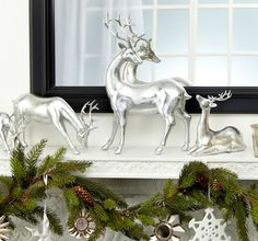 I like this and the fact that when you put something in front of a mirror - you get two for the $ of one. Mantel decorated with silver deer, greens, snowflakes, etc.