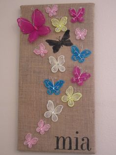 butterfly wall art in different lovely color also light brown canvas also different sizes and a little graffity for your girl room interior decor