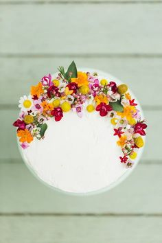 These Edible Flower Wedding Cakes Are Next-Level Gorgeous - Brit + Co Bolos Naked Cake, Naked Cakes, Pretty Cakes, Beautiful Cakes, Amazing Cakes, Edible Flowers Cake, Wedding Cakes With Flowers, Flower Cakes, Fresh Flowers On Cake