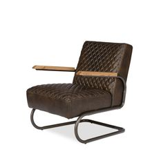 With the Beverly Hills Arm Chair Java, you can build a room filled with vintage beauty. The luxurious look of the past, brought to life with leather, wood, and metal parts, is ideal for creating an environment of rich refinement. Place it in a man...