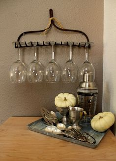 You Can Turn An Old Rake Into A Wineglass Holder