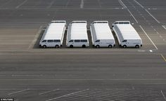 Not a glitch in the Matrix: A number of Nissan vehicles are parked at the company's factory in Yokosuka, south of Tokyo, Japan, in November 2009