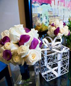 I like the white roses and purple calla lilies